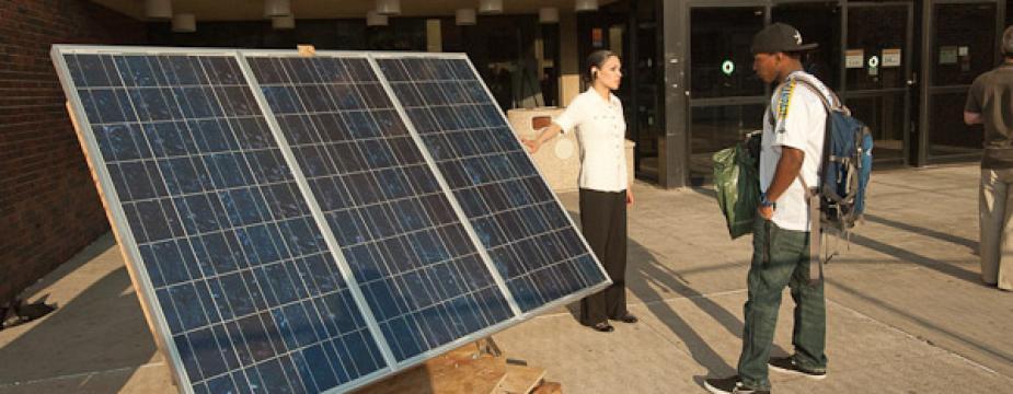 Students looking at solar panels